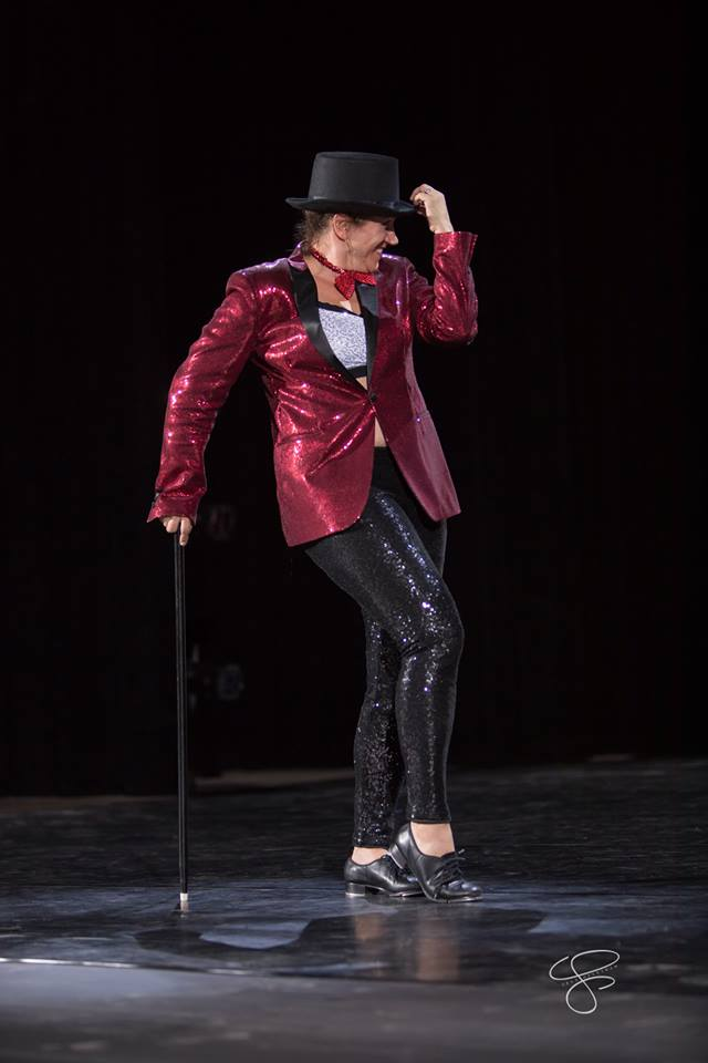 This image has an empty alt attribute; its file name is Gina-showman.jpg